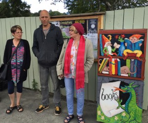Ruth Arnison, founder of the Lilliputian Libraries, Marty Cancilla, director of the NEV project, and Pat McCarty, the artist who decorated the book fridge, at the Leap Year Launch.