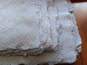 sheets of rough grey recycled paper