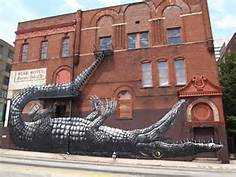 Street art of a giant crocodile on a building